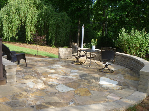 This Lovely Earthtone Craborchard Flagstone Patio Has A Curved Belgard  Celtik Wall Bench For Casual Sitting. We Added LED Landscape Lighting Under  The ...